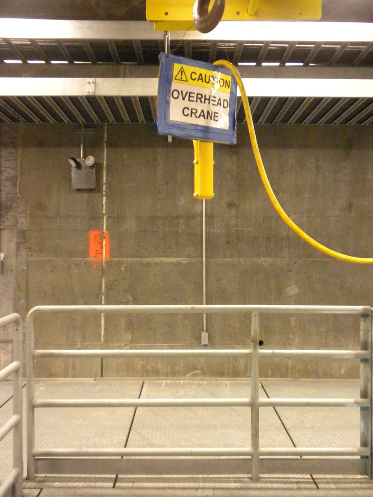 When we went into the bridge, we first entered the electrical substation. The crane shown here is located above doors in the floor that open to lift equipment into the bridge from the bay below for repairs and maintenance.