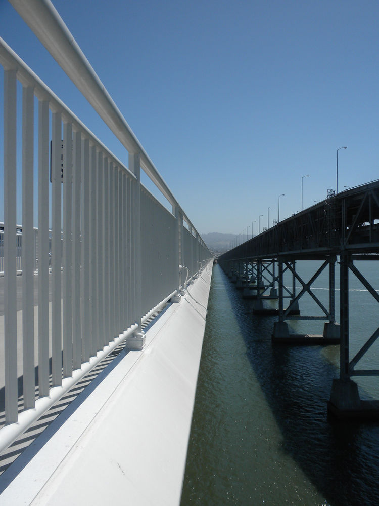 The new skyway stands in stark contrast to the old Bay Bridge but the two have been intensely linked together because one of the three requirements of the new Bay Bridge project was to keep one bridge open and functional throughout the duration of constru