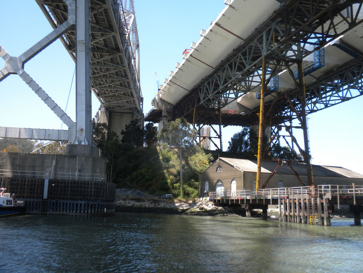 The eastern edge of Yerba Buena Island is where traffic will exit the tunnel through the island and travel onto the new bridge (shown on the right). What fascinated me was the small, boarded-up structure that is located at the base of the bridges and that