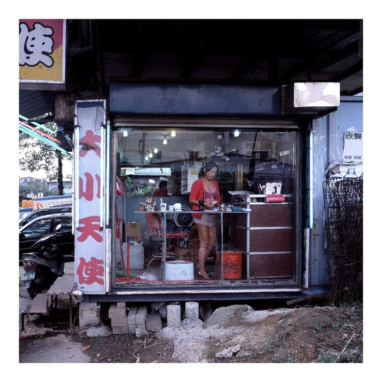 """There are two types of stores: mom and pop shops that are family run and like normal shops, and then the Betel Nut girls shops with the neon signs and glass window that really put the girl on display."""