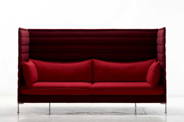 Alcove Sofa Highback, Vitra, 2007. Alcove highback loveseat with integrated desktop Chromed steel, polished aluminium, fibreglass, foam, fabric, MDF, leather. 1265 × 840 × 1360 mm/50 × 33 × 53.5 inches; Vitra, Switzerland