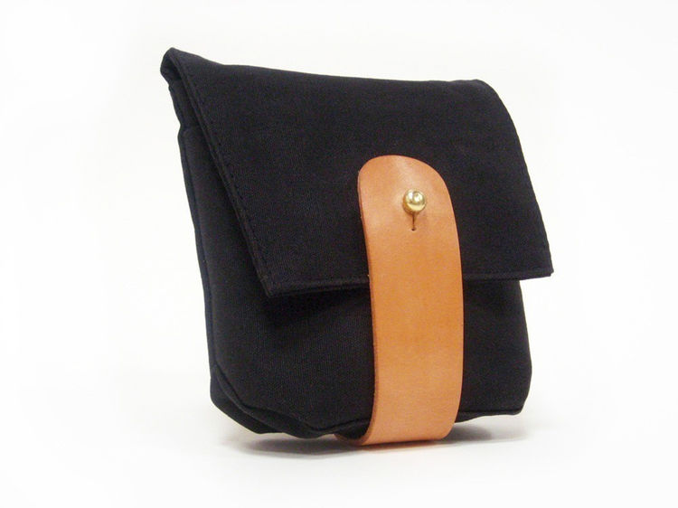 """Waxed Canvas Hip Pouch designed and manufactured by Death and Texas. """"One of our favorite local brands. Grace Teng makes all of her products by hand right here in Williamsburg."""" Available at <a href=""""http://brookfarmgeneralstore.bigcartel.com/product/hip-"""