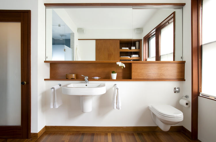 """Whenever you're making a minimal bathroom, you always have issues with storage,"" Klug says. The wall-hung <a href=""http://www.duravit.com"">Duravit</a>sink leaves no place ""to put all your junk,"" so Klug and Butz added small shelf above. The space to the"