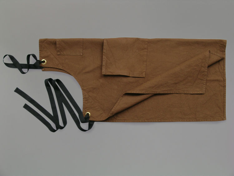 """<b>Brown Canvas Apron</b> """"We produce this apron. Made of a very functional heavy duty canvas, this apron has now been adopted by several restaurants and stores."""" Photo courtesy of Labour and Wait."""