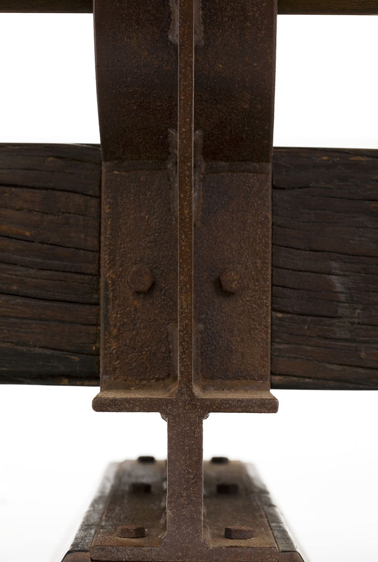 """Designed in 2009, the Butantã bench is held together by small, patinaed iron I beams. Photo courtesy <a href=""""http://espasso.com/home.asp"""">Espasso</a>."""