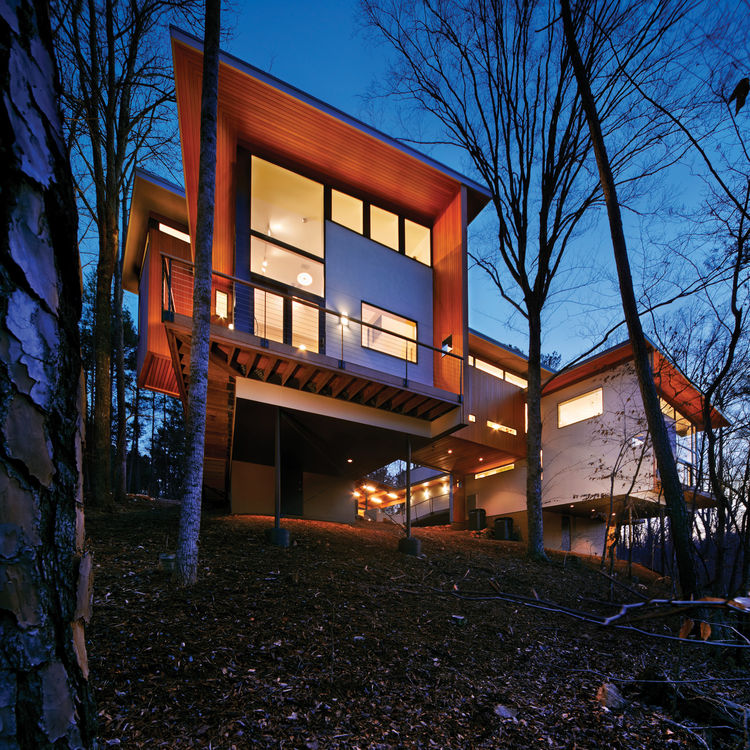 The complex, perched on a slope overlooking a forest owned by Duke University, has an 800-square-foot artist's space and a 2,400-square-foot house.
