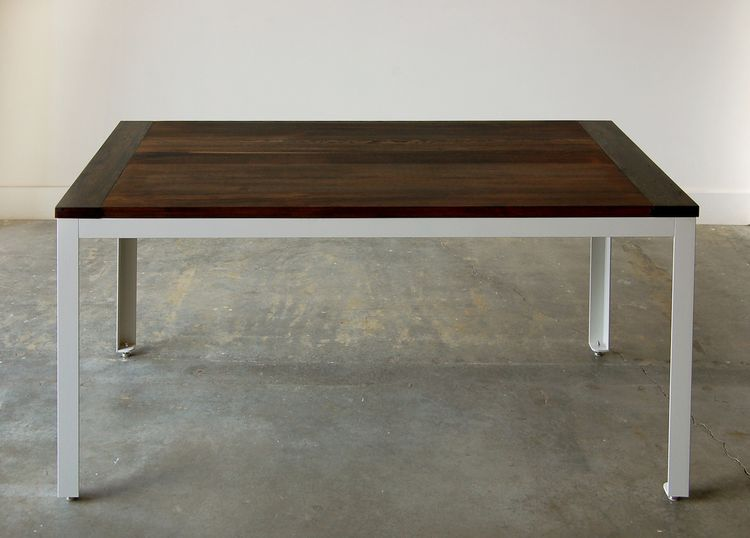 Made from local, recycled and reclaimed materials, the Farmhouse Modern kitchen table melds the traditional with the contemporary. The patinated fir table top has 'breadboard ends' (a special kind of joinery method) and sits atop a sleek powder coated ste