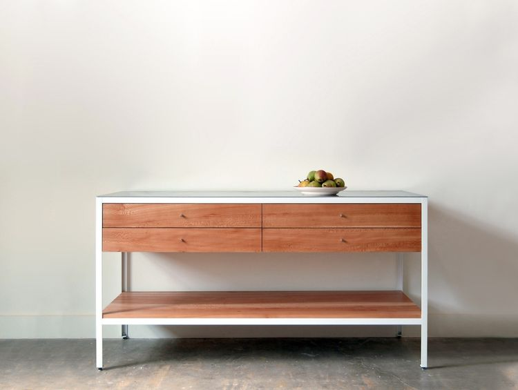 The 'Farmhouse Modern' sideboard shown here is made from sycamore, heavy gauge stainless steel and white powder-coated steel. The sideboard is also available in other woods and colors such as Oregon walnut with black powder coated steel.