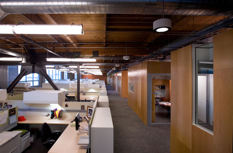The LEED-certified space features timber-based palette with hits of orange, green, and blue.