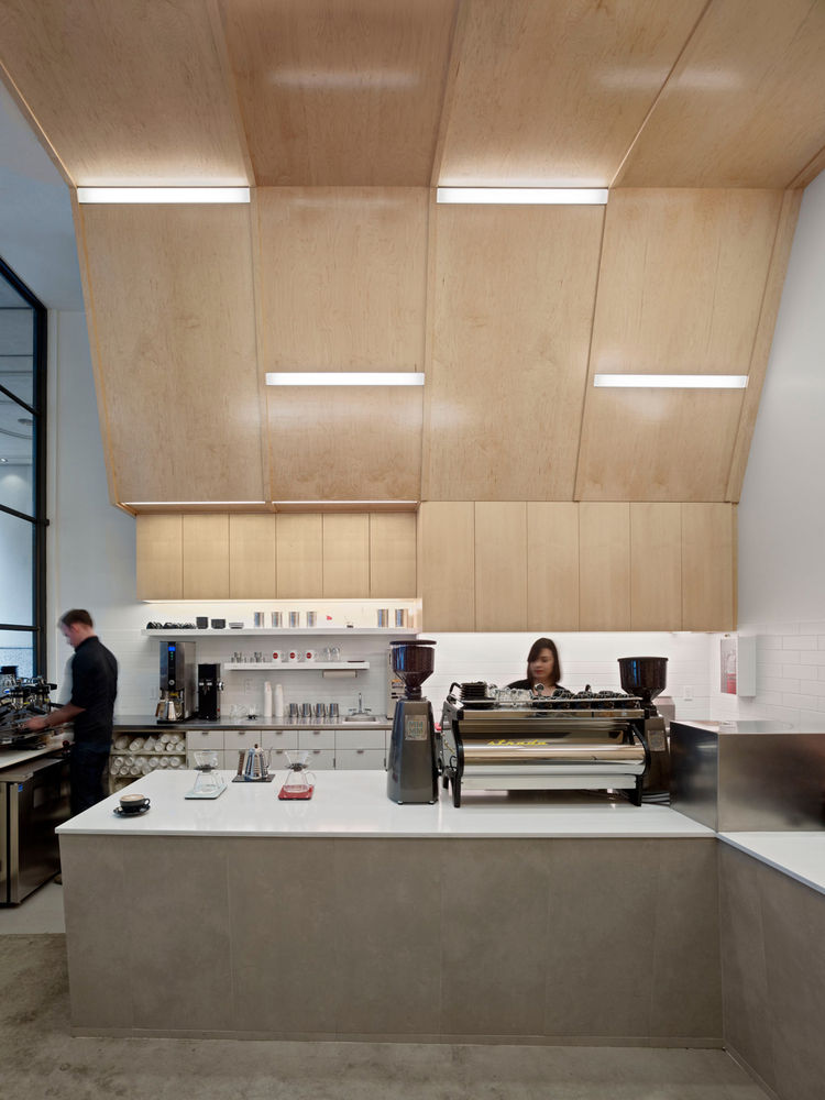 """Conceptually, we've highlighted the interaction with the baristas as a theatrical experience,"" says Jones. ""The idea was to keep counters low, and transparent so you can see things being made."" The countertops are Caesarstone and the porcelain tile (pain"