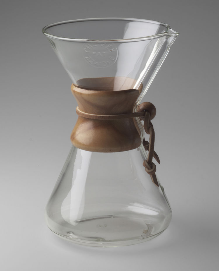 The iconic Chemex Coffee Maker was designed by German-born American designer Peter Schlumbohm, manufactured for the Chemex Corp. in 1941. Inspired by Bauhaus design and his own personal need for a coffee maker, Schlumbohm based the design on an Erlenmeyer