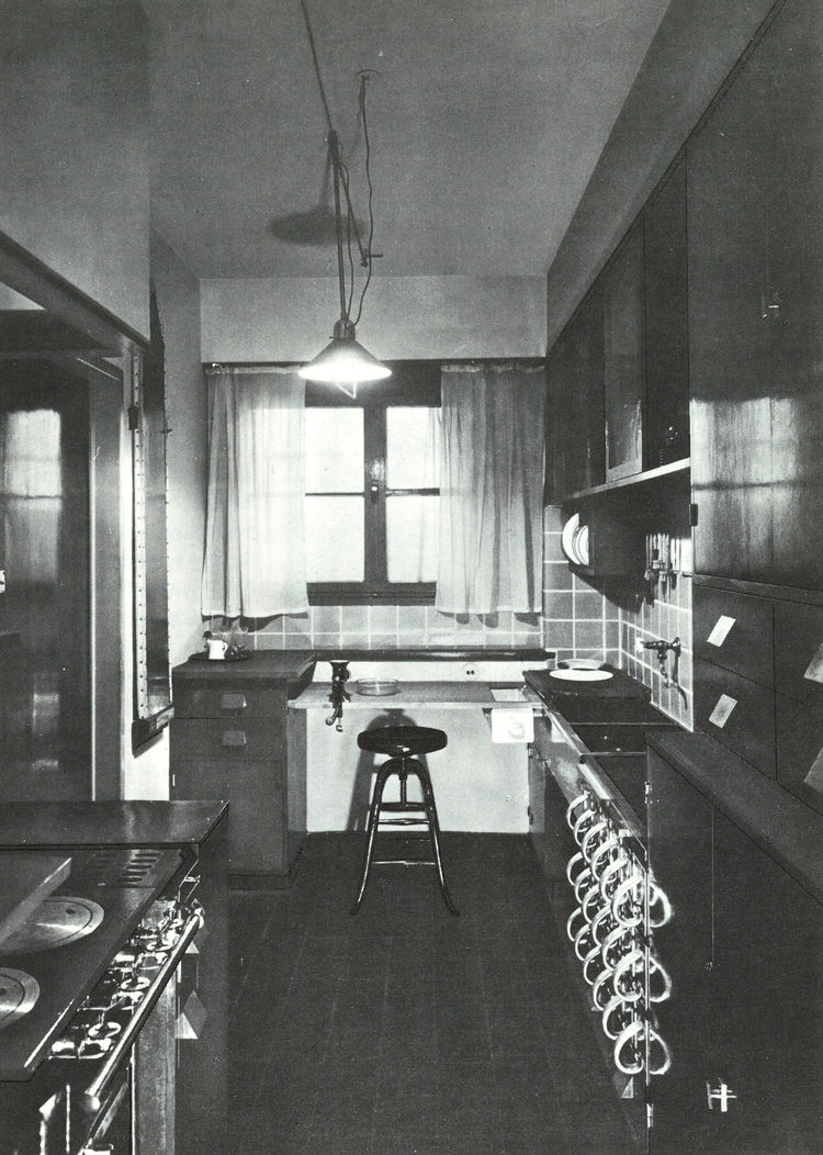 This photograph of a Schütte-Lihotzky kitchen in a home in Frankfurt am Main shows how the area fit into the context of the house as a galley.
