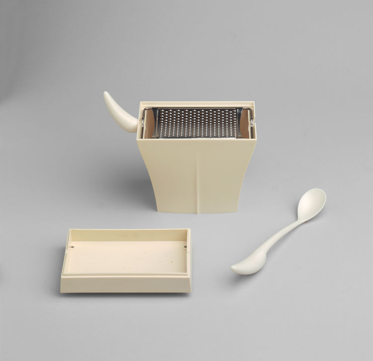 Also designed by Starck is the Mister Meumeu Cheese Grater. Made of ABS plastic polymaid and stainless steel, the grate catches the cheese in the container and offers a horn (which becomes a spoon) to scoop it out.