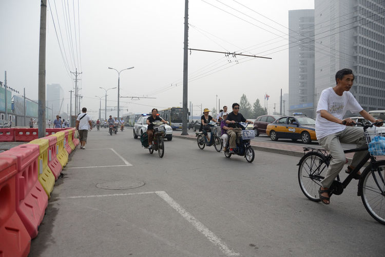 "Upon landing in Beijing on a hazy afternoon, Shahid headed over to AECOM's office to meet designers living in the city. On the streets, ""bikes, pedestrians, and cars share a separated lane,"" she notes. Why the car, we're not sure."