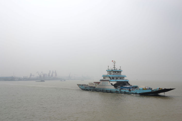 """Bikes are prohibited on the bridge where Shahid planned to cross the Yangtze River. Instead, she rode on a ferry like the one shown in this image. """"The ride was everything but a romantic river cruise thanks to the smog blocking the view across the river,"""""""
