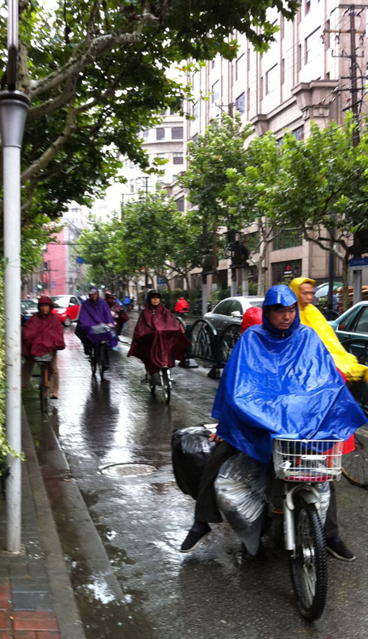 """The rain, however, didn't stop the local cyclists in Shanghai. """"The bike lanes were still just as crowded as in good, sunny conditions,"""" Shahid says."""