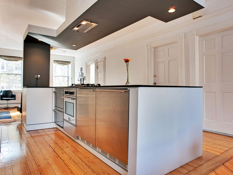 """Chris's original design consisted of only the island, which houses two <a href=""""http://www.fisherpaykel.com/product/dishwashing/dishwashing/index.cfm?productuid=C8CF35D2-EF9D-E58B-62EC36C047BA7F80"""">Fisher Paykel dish drawers</a> as well as a 24-inch gas o"""