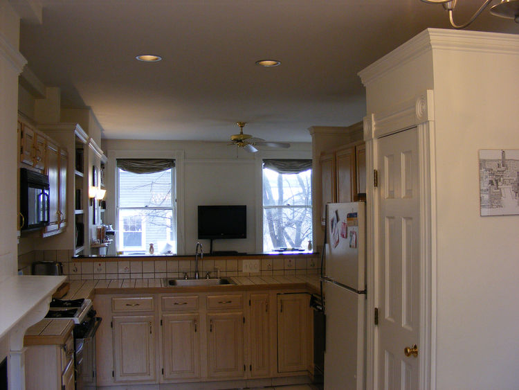"""The existing kitchen had been remodeled in the mid-1980s and """"had been pretty hastily done,"""" Chris says. The cabinet joints had started to fail by the time the Greenawalts moved in but worst of all, the layout, with the unit's entrance leading immediately"""