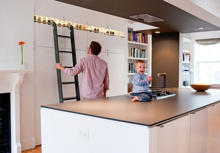 """Before relocating to the second-floor, 950-square-foot unit in a traditional Boston brownstone, Chris (picture here with his and Danielle's now 14-month-old daughter, Chloe) worked at <a href=""""http://www.pbelemental.com/index-2.html"""">Pb Elemental Design</"""