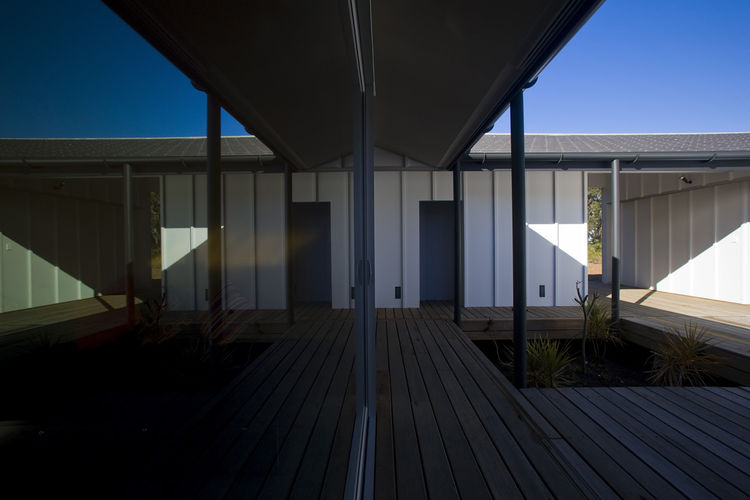 """""""A monopitch roof wraps around the courtyard, simplifying roof drainage and providing unity,"""" says Blue."""