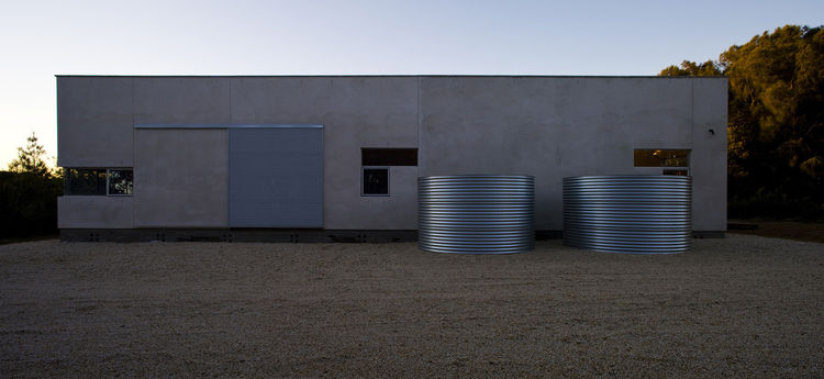 The two corrugated-steel water cisterns create their own architectural gesture and, because they are capable of holding a total of 5,000 gallons of water, could prove useful in the bushfire-prone area. Blue points out that the building had to be designed