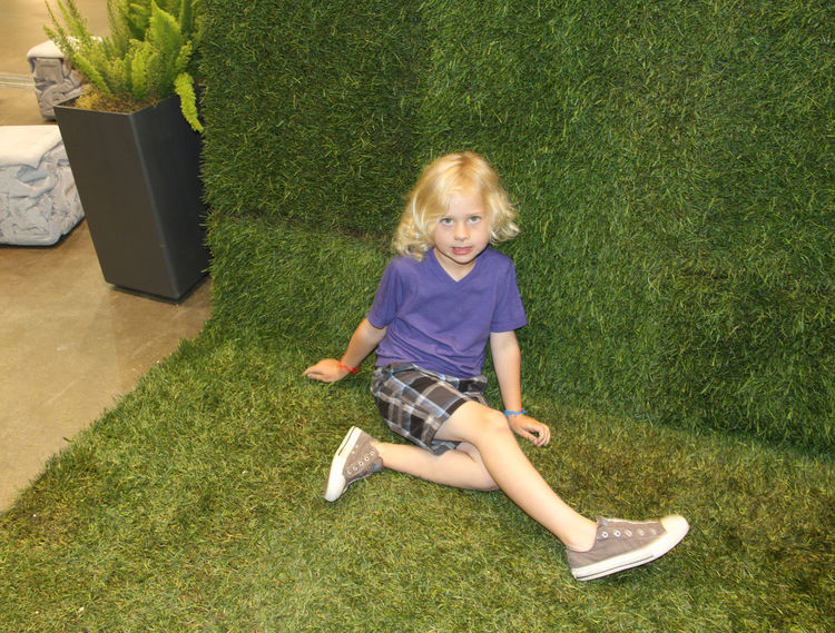 """Landscape architecture firm <a href=""""http://www.shadesofgreenla.com"""">Shades of Green</a> clad their booth completely in sod, which proved too tempting not to experience close-up."""