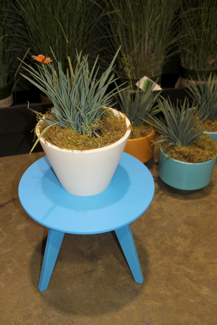 """A delicate but durable round table in blue by <a href=""""http://www.lolldesigns.com/welcome.php"""">Loll</a>, which makes its furniture out of 100-percent recycled plastic. And it looks much nicer than an old water bottle. The planters, much-coveted on the sho"""