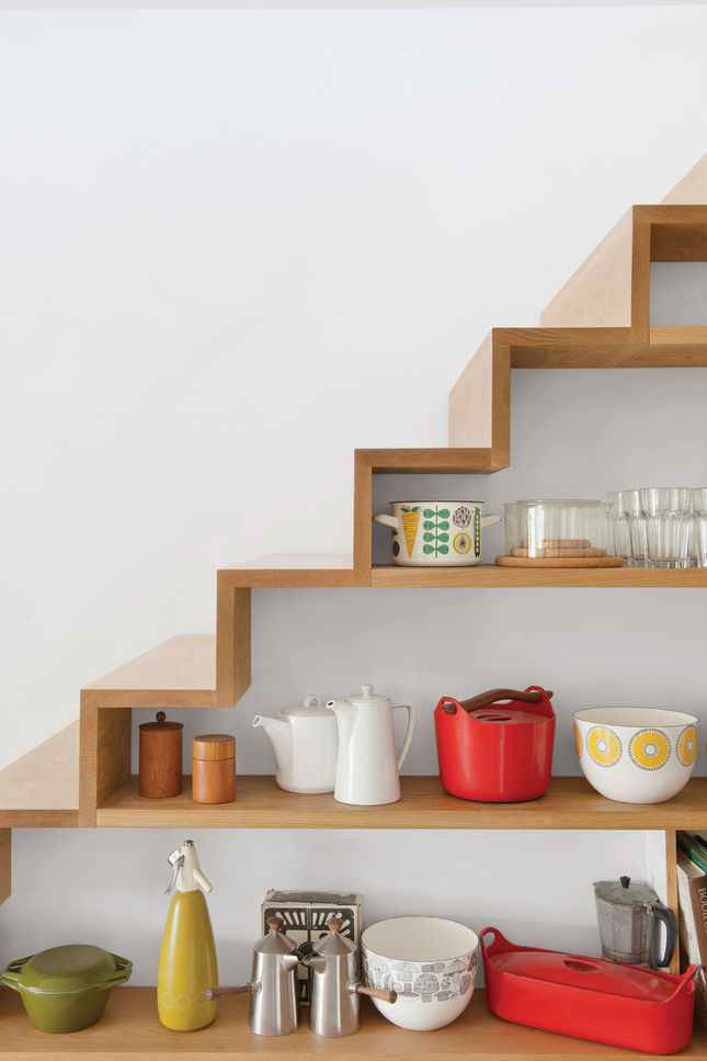 "Restorick also built this quirky oak staircase with open shelving along one side. ""I use accessories as the color in spaces,"" says Tyler, ""so these items are an integral part of the overall design."""