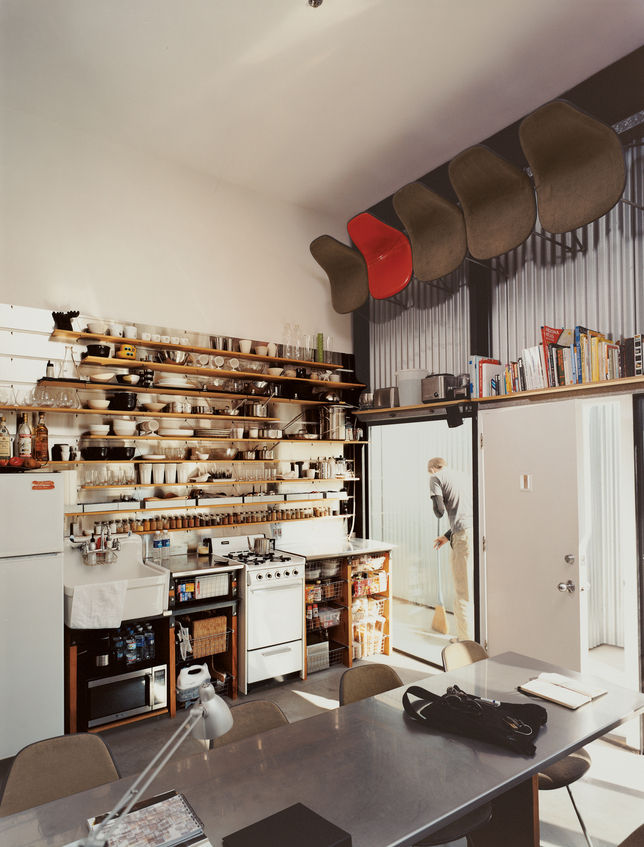 In a 15.5 by 20-foot studio apartment, space is at a premium, to put it lightly. The resident, a designer, sized his kitchen shelves to accommodate specific kitchen gear: narrowest at the bottom for spice jars and juice glasses and widest at the top for p