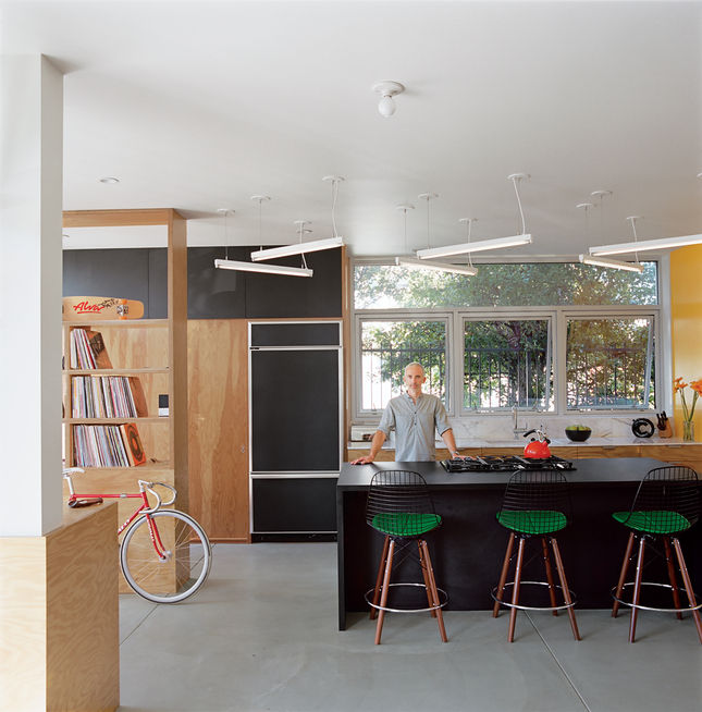 """Riffing on the Los Angeles phenomenon of people """"murdering out"""" their cars—that is, removing all the trim and blacking everything out—architect Barbara Bestor and craftsman Eric Lamers covered most surfaces in <a href=""""http://www.dwell.com/slideshows/surf"""