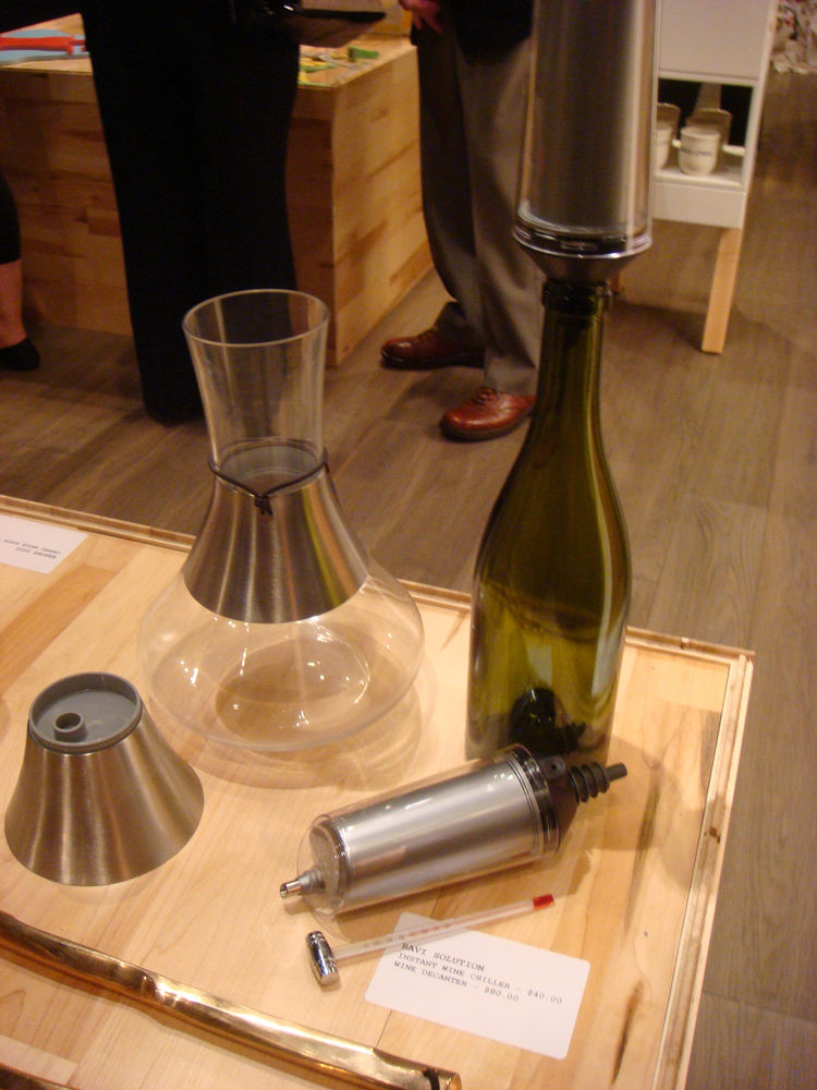 """<a href=""""http://www.ravisolution.com/"""">The Ravi Solution wine chiller</a>, designed by Michael Dallaire, works by attaching a device that's meant to be stored in the freezer to the top of any wine bottle, instantly chilling the liquid as it's poured."""