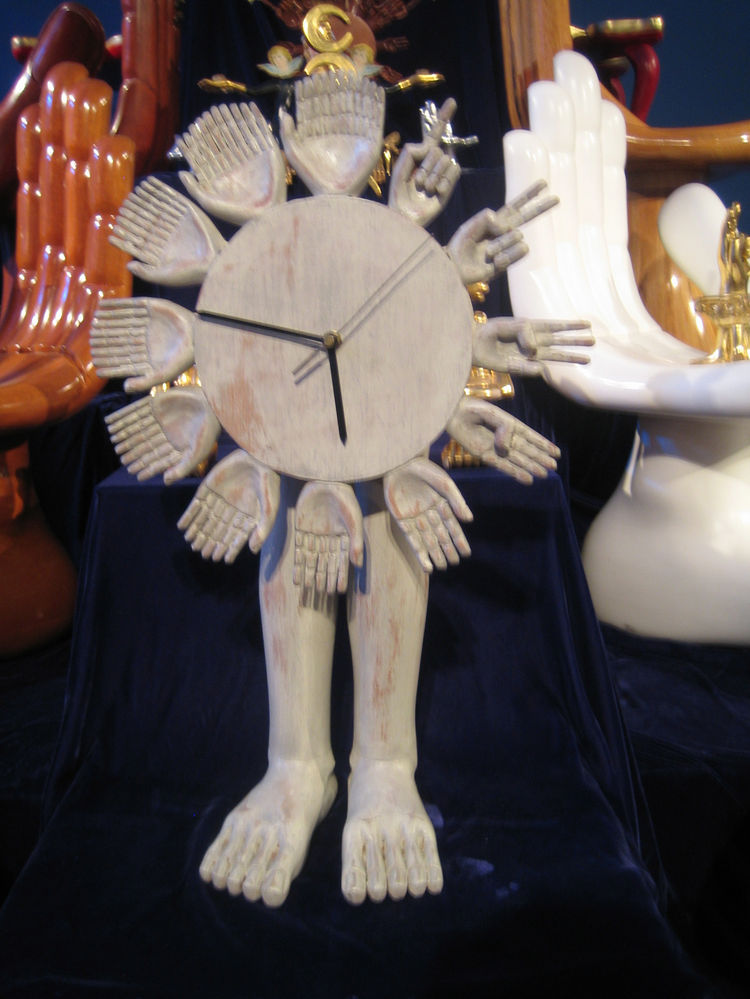This is my favorite of the Friedenberg canon on display. An R. Crumbian clock with both hands and feet, as you move around the dial the hours are represented with more and more fingers. Once you get to 12 they are too many to count, but certainly convey t