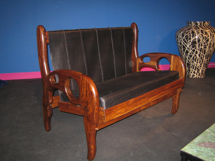 The organic curves of this loveseat from Don Shoemaker fits nicely with the chair from the previous slide. It too is made of cocobolo, a wood in the rosewood family, though not nearly as threatened environmentally. The wood is very hard, so hard that Shoe