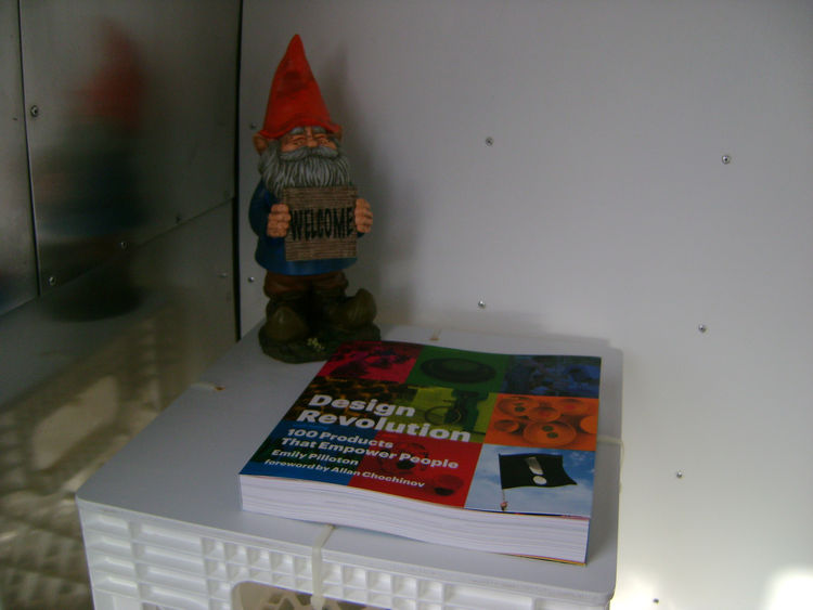 "Just inside the Airstream is Pilloton's ""welcome gnome"" and a copy of <a href=""http://projecthdesign.org/designrevolution.html""><i>Design Revolution: 100 Products that Empower People</i></a>."
