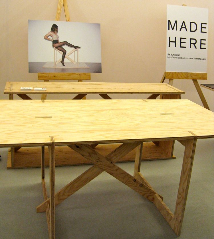 "This knock-down plywood table from Swiss designer <a href=""http://www.colinschaelli.com"">Colin Schaelli's</a> <a href=""http://www.ownlineshop.com/ch_de/con-temporary-furniture.html"">con.temporary</a> line is made in Japan, as the sign to the right indicat"
