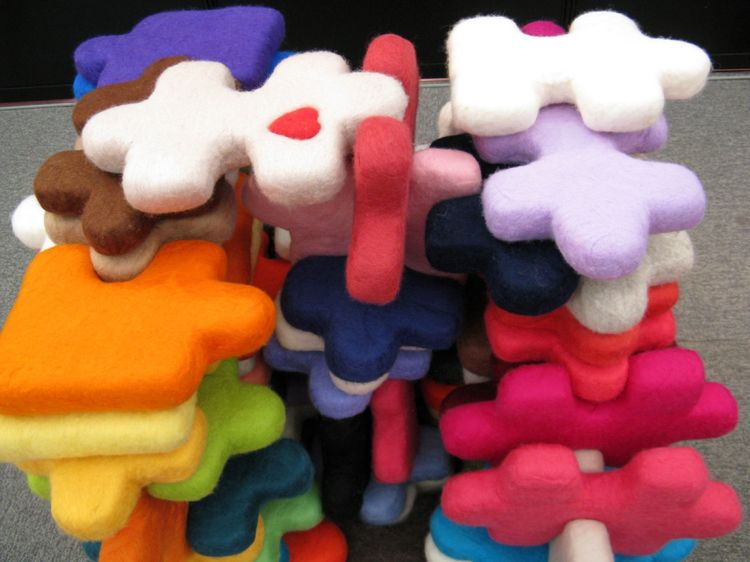 These felted puzzle cushions are cottony-soft and entertaining to boot. Too bad their designer, Rumiko Ishikawa, is still a student at Kawashima Textile School and the design is not in production.