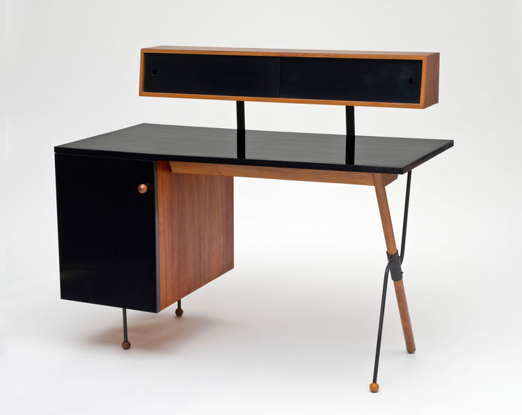 Greta Magnusson Grossman, who was born in Sweden, made this formica, walnut and iron desk for Glenn of California in 1952. Also an architect, Grossman designed homes in Los Angeles, San Francisco and Sweden.