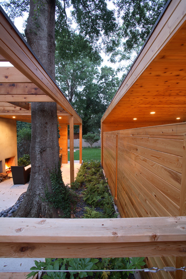 To save the tree, Carpenter called in an arborist, who helped Carpenter and the Domineys nurse it back to health. Carpenter then built the parts of the pavilion around the tree, moved the foundation away from the roots, and used permeable concrete slabs s