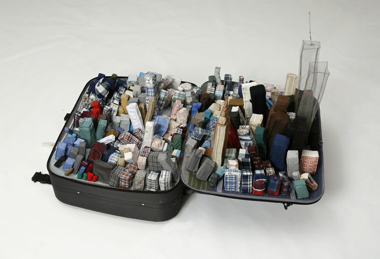 <i>Portable City, New York</i> (2003) by Yiu Xiuzhen. Suitcase and used clothing. 35.5 inches by 55 inches by 12 inches. Courtesy Alexander Ochs galleries Berlin/Beijing. © Yin Xiuzhen
