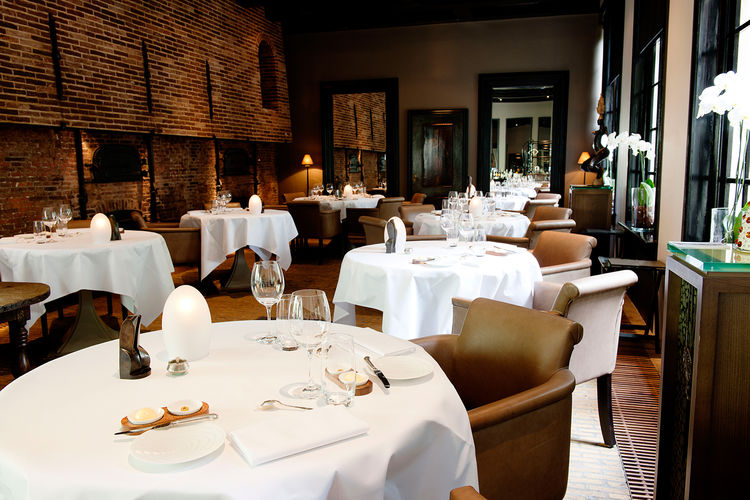 "The hotel's elegant Michelin-starred restaurant, Vinkeles, was formerly a bakery, in operation between 1787 to 1811 and run by the ""Catholic Old and Poor People's Office."" The sunken dining room is surrounded by original 18th century ovens."