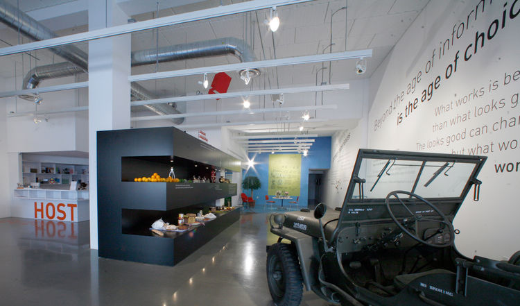 """To the left of the big E is the museum's reception area, which has been labeled """"Host,"""" with a double meaning: One, the obvious, and the other, a reference to Charles and Ray's preoccupation with the Guest/Host relationship, in which the experience of the"""