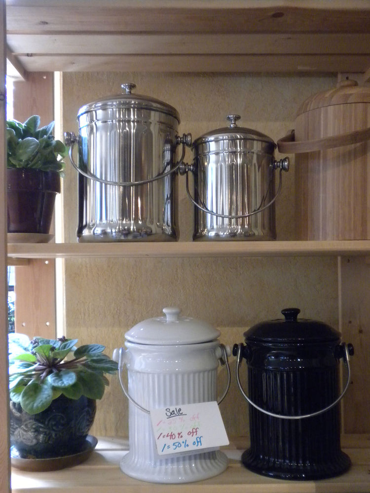 "One popular set of products at Eco Carmel are the compost bins. ""They're a necessity for diverting material from landfills,"" Reimers says. On display are stoneware, metal, and bamboo models from <a href=""http://www.rsvp-intl.com"">RSVP International</a>. T"