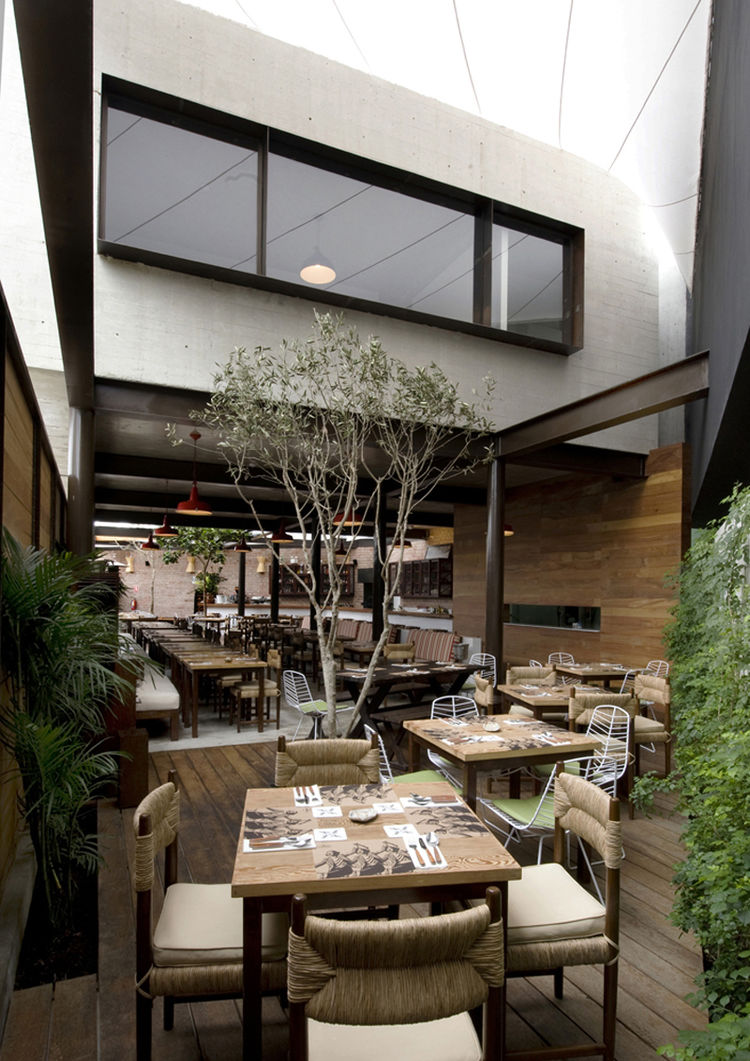 "The first-floor space between the two second-floor structures creates one of two dining patio. ""The chef wanted a fresh space that would basically be like an open market,"" Ortiz de Zevallos says."