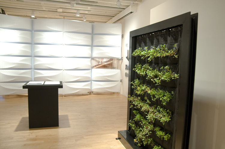 "At the exhibition, Mary Ellen Carroll's <i>Hydroponic Curtain Wall</i> stands near <a href=""http://www.houminn.com/"">HouMinn Practice</a>'s white <i>OSWall</i>. Photo courtesy Diana Pau."