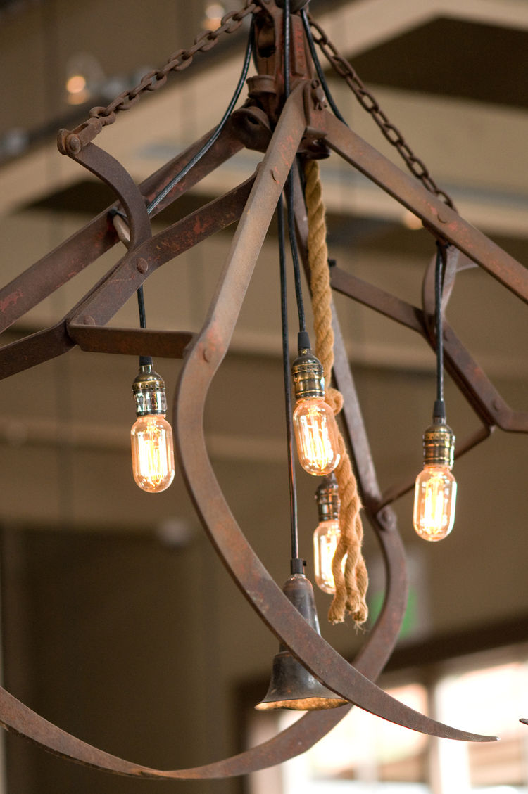 "Less threatening found objects are the metal hay hooks that Johanson fashioned into light fixtures with the help of Lew Rosenberg at Electrics Architectural Lighting. ""We found them up in Napa at a resale store that sells old junk,"" Johanson says. ""We wan"