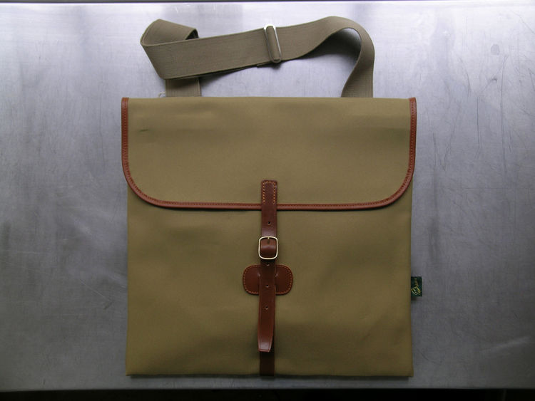 """<b>Folio Bag</b> """"An archive design selected from the manufacturer's archive. We love the traditional craftsmanship, combined with a contemporary look. Very useful for carrying a laptop."""" Photo courtesy of Labour and Wait."""
