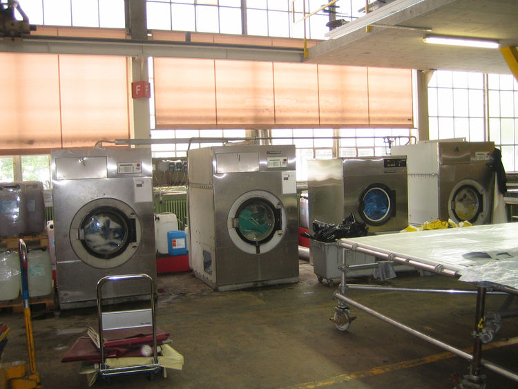 From there it's into the industrial washing machines to clean the tarps up for production.
