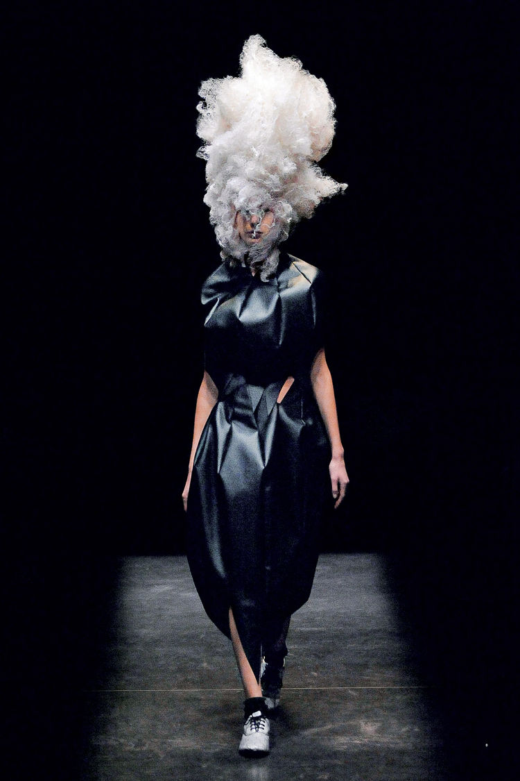 Here's a synthetic leather skirt and top by Kawakubo for Comme des Garcons from the Spring/Summer 2009 line. Pret-a-porter it's not. At least not the headpiece.