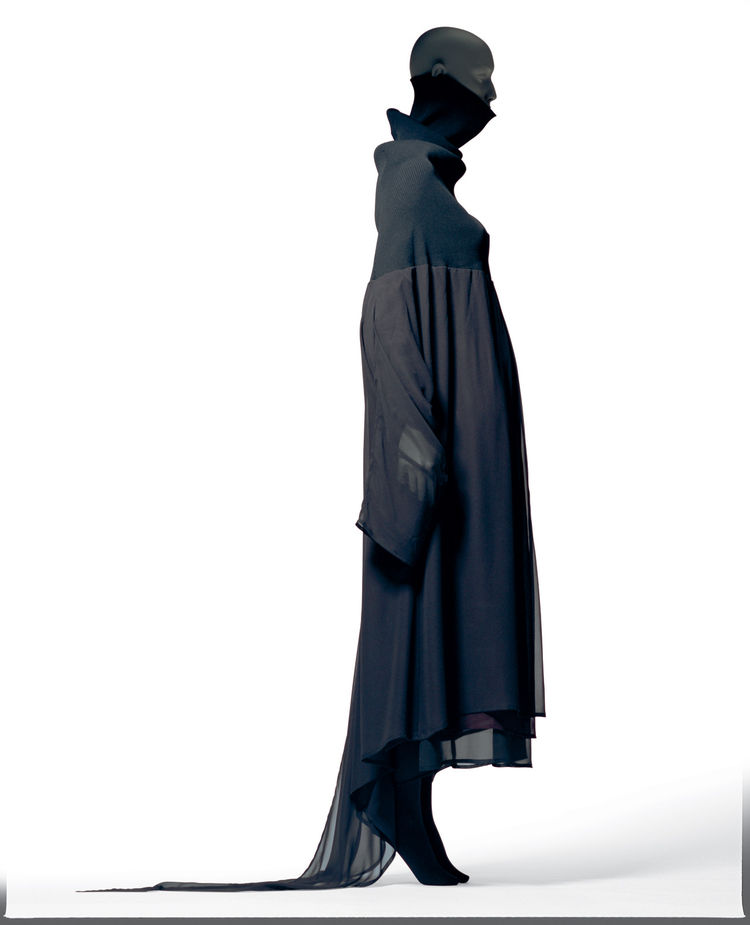 Kawakubo's designs rarely hug the body, instead working with a play of light and shadows, volume and drape. This dress is from her Autumn/Winter 1992-1993 collection for Comme des Garcons is made of purplish brown polyester Georgette (two sheets as sleeve