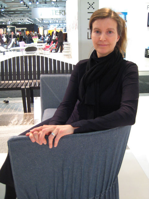 Designer Anna von Schewen, seated on her Dress sofa.